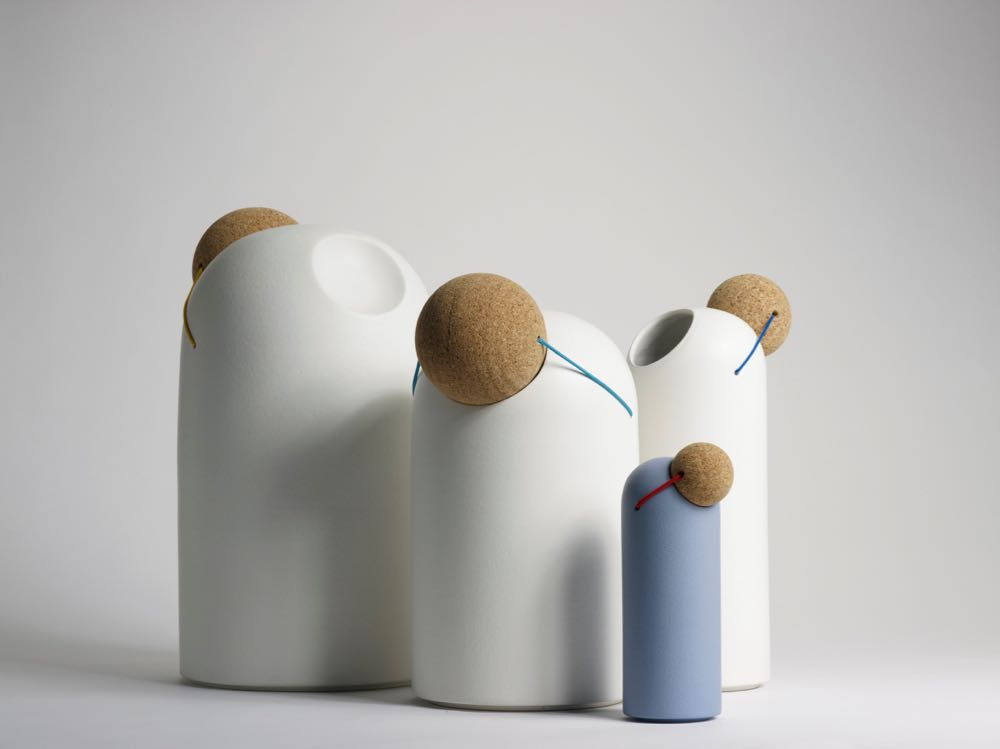 Tomas Kral's  porcelain water vessels 'Clown Nose' (2010) feature stoppers made from turned cork that are joined to the vessel by elasticated cord. When being used the cork is rested on an indentation on the back of each vessel.