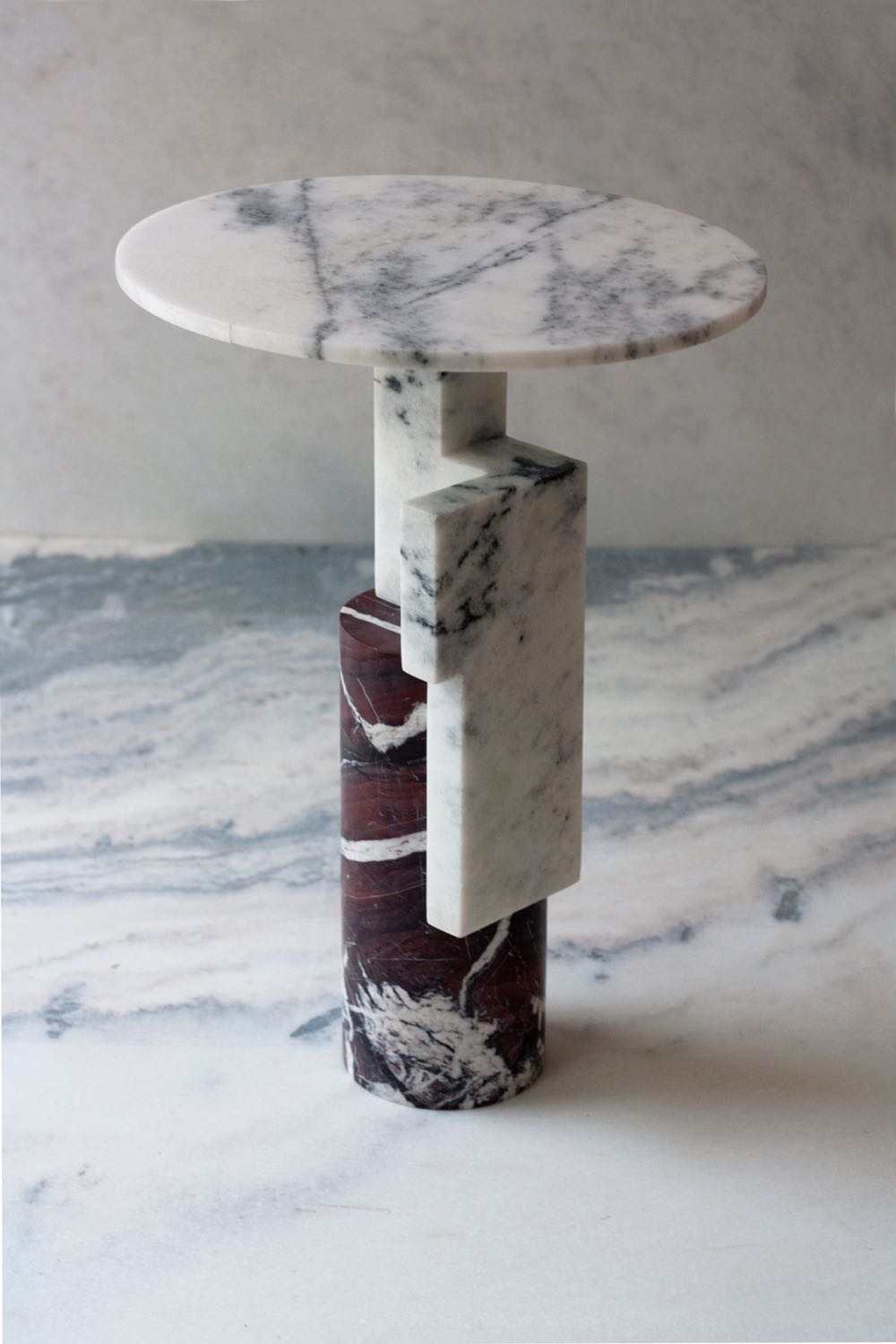 Raw Material 'Offcut 1' side table in two contrasting marble types. Cylinders, circles and planes come together.