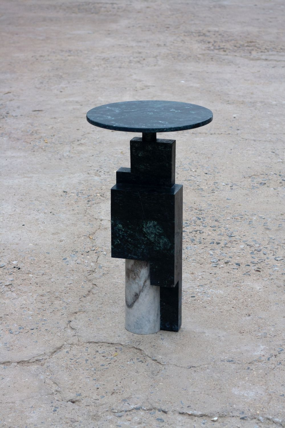 Raw Material 'Offcut 1' side table in several marble types. Cylinders, circles and planes come together.