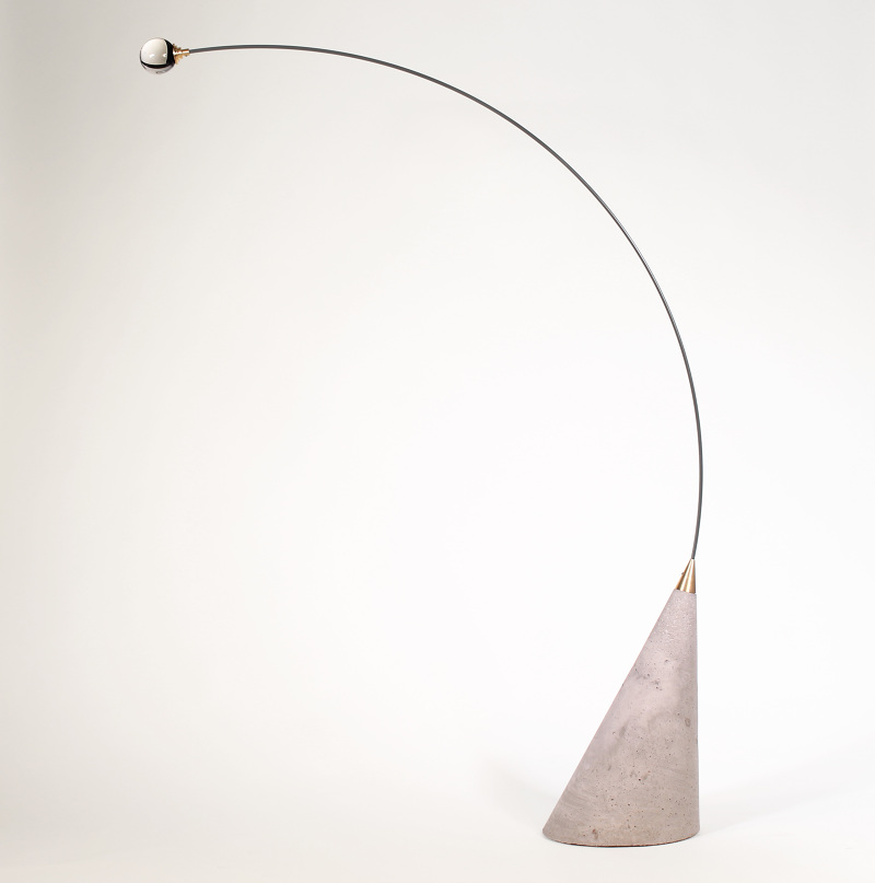 The 'Gravity' light sculpture by Elina Ulvio 2015. Made from concrete, glass, brass and spring steel, the object combines an audacious form with time-honoured materials.