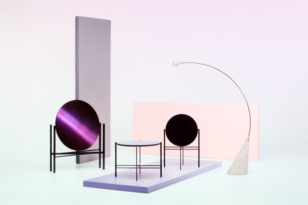 Objects from Elina Ulvio's  LSD  collection showing her 'Kuu' reversible table and 'Gravity' light sculpture. Photograph by Annikki Valomieli.