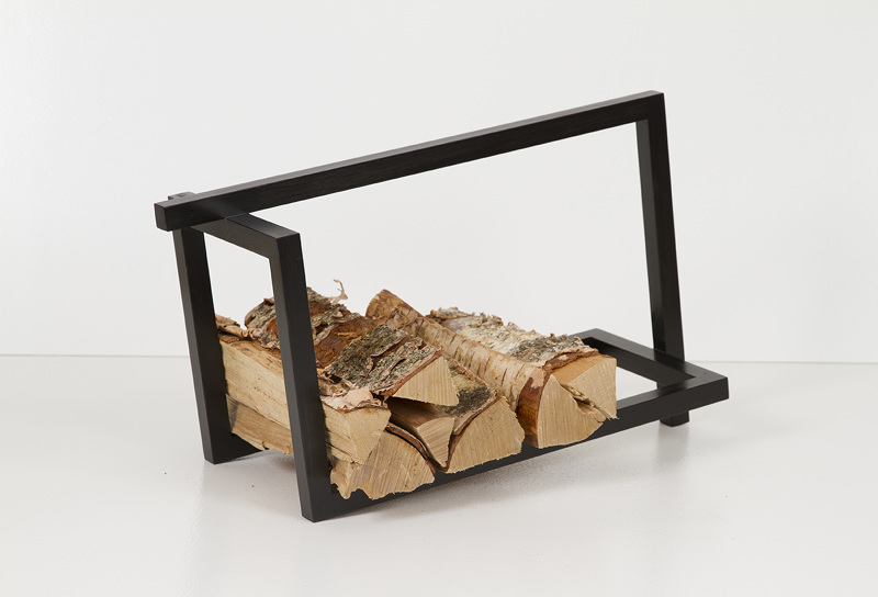 The 'Woodi' is a rack for firewood or books by Elina Ulvio (2016) in black stained solid birch. Photograph: Karin Ulvio.