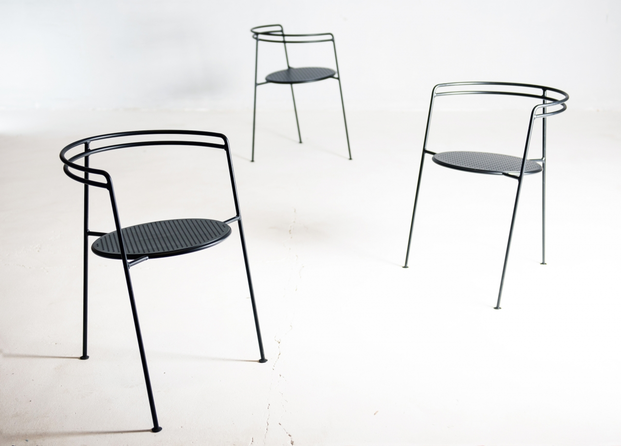 The 'Point' chair is a stackable outdoor design in perforated sheet steel and solid steel bar. The double back rest provides a poetic look and a possible improvement on the ergonomics of minimalistic steel designs.