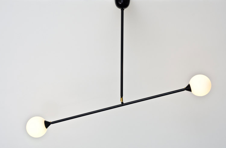 Atelier Areti's 'Two Spheres' light from 2010. Balance or lack of it is left up to the user with the provision of a central pivot.