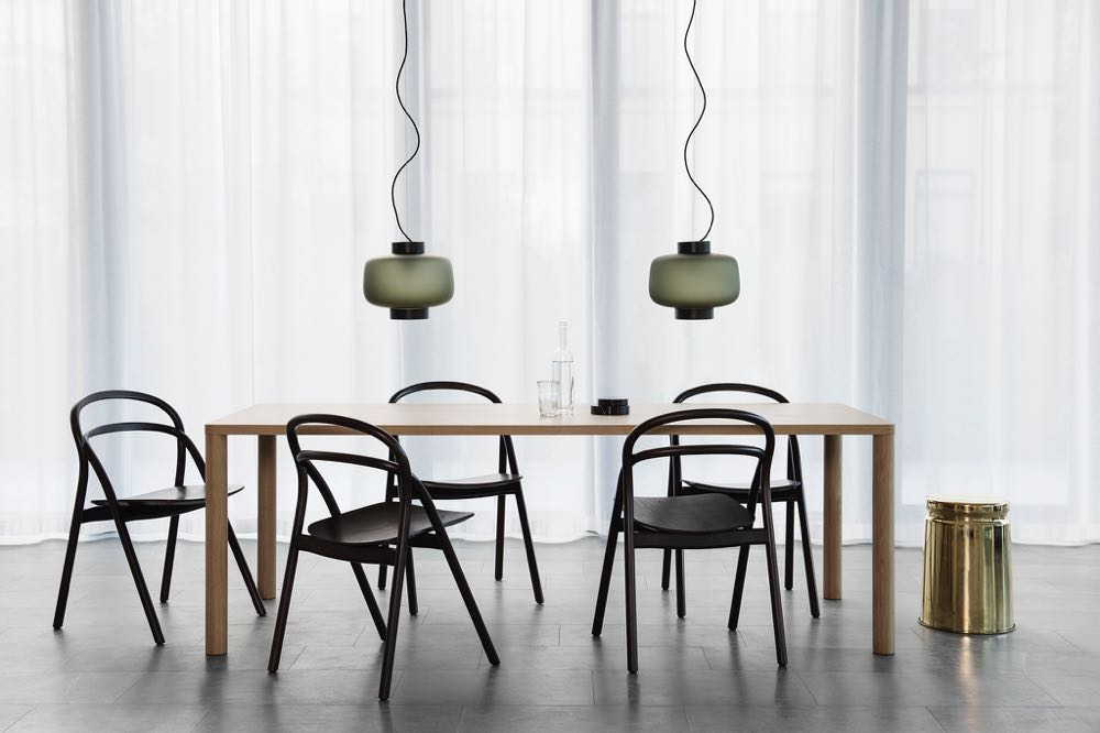 One of Hem's new releases, the 'Udon' chair by Staffan Holm. Pictured with the 'Log' table by Julian Renault, 'Dusk' pendant lamps by Sylvain Willenz, and the 'Last table' in brass by Max Lamb - all from Hem.