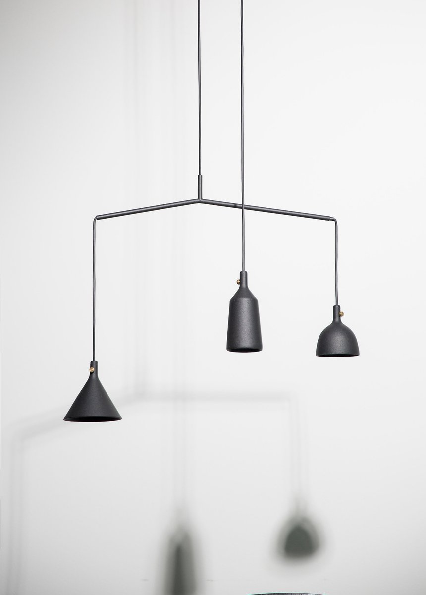'Cast Pendant' by Jordan Murphy and Tom Chung for Menu. The design comes in three shapes but is shown here with two shades on a spreader, with a third pendant hanging independently.