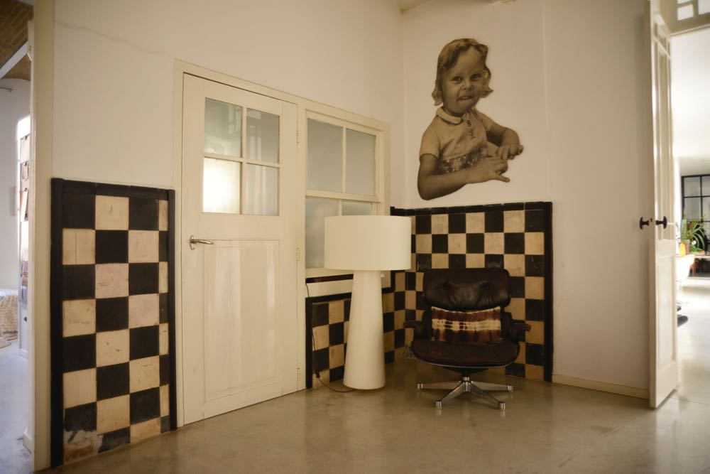 Original doors and tiles surround the old factory's accounts office. The artwork of the young girl is actually a printed and quilted fabric image of Mary Hessing, the editor of Woth, as an 8 or 9 year old. It was a gift from an artist friend.