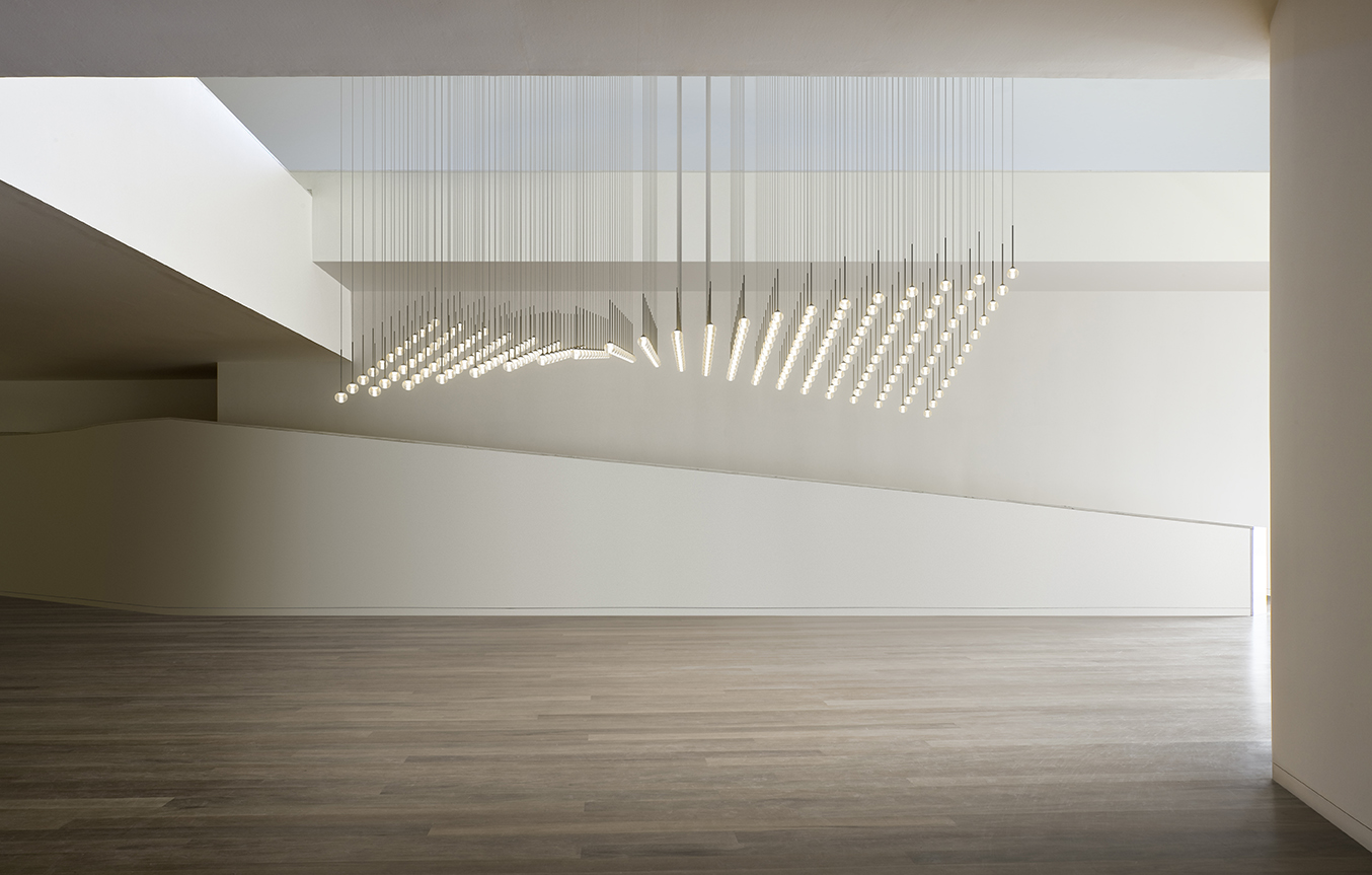 Spanish lighting brand Vibia will launch a new lighting concept 'Algorithm' by Toan Nguyen. Glass spheres are suspended in  a curvilinear plane.