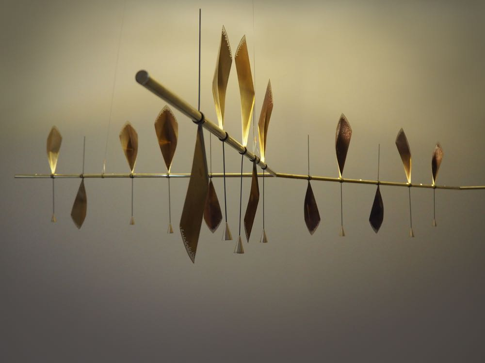 Umut Yamac's 'Flutter' - part light, part kinetic sculpture using leaf-like patinated brass and LED.