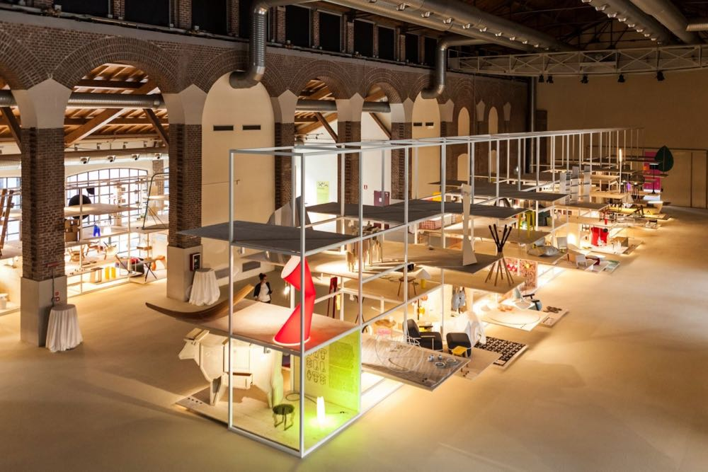The exhibition Salone Satellite: 20 years of New Creativity curated by Beppe Finessi. The exhibition was held in the vast cathedral-like hall of Fabbrica del Vapore near Porta Garibaldi. Helen Kontouris' 'La La' lamp for Kundalini can be seen in red in the foreground. Photo by Andrea Mariani.