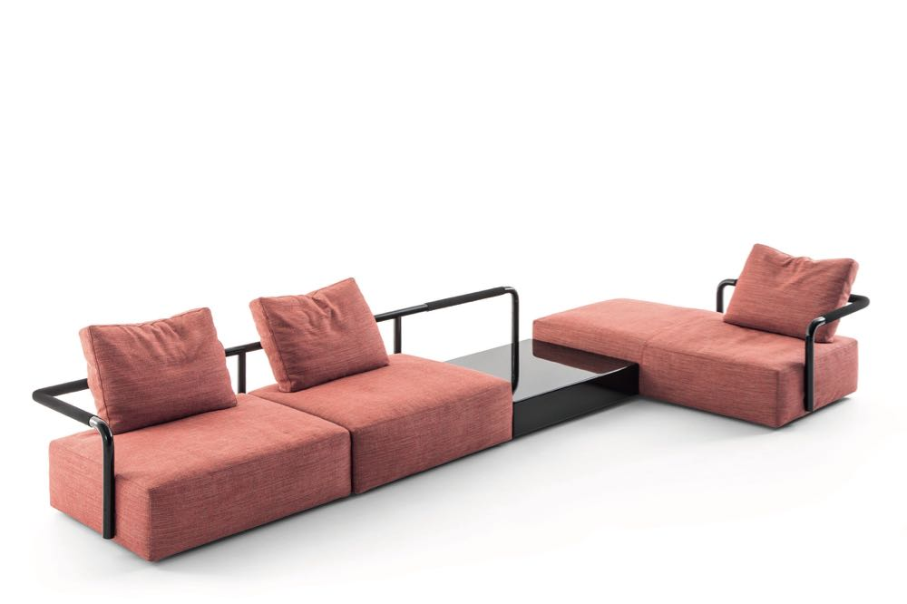 Konstantin Grcic's sofa system 'Soft Props' for Cassina - inspired by handrails found in the Milan metro. Pushing blush in the direct of coral the combination with the hard black handrails is very striking.