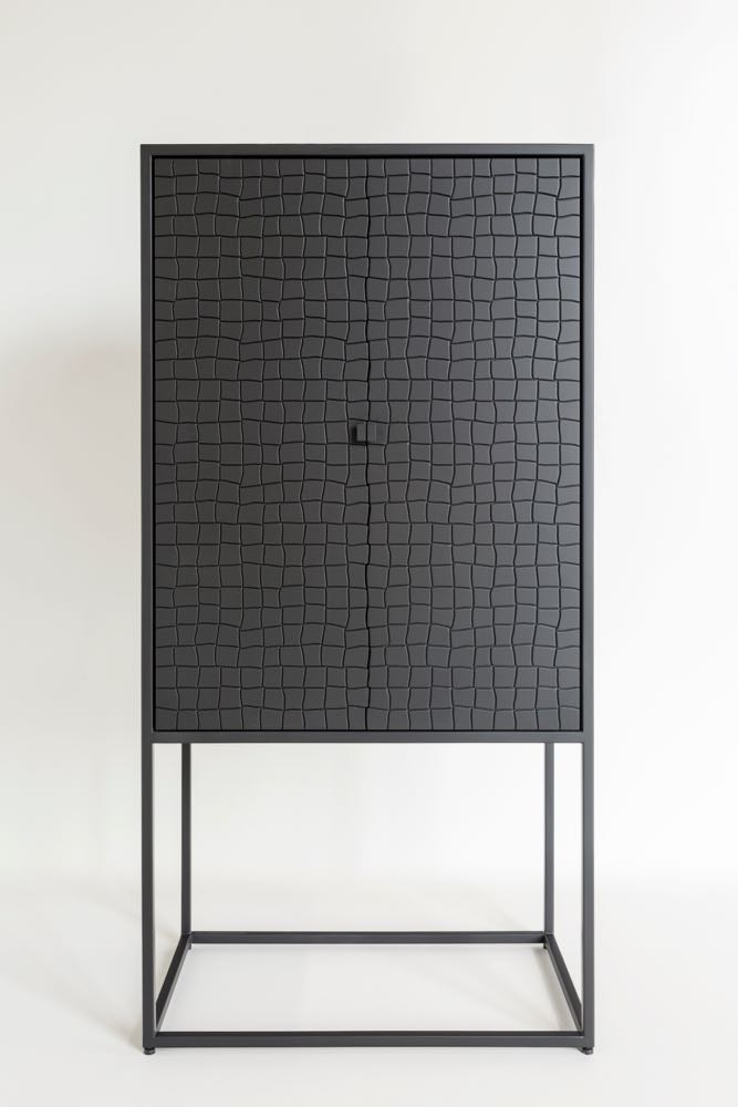 The 'Basso' cabinet by Gustavo Martini for Brazilian company AuCap. The cabinet also comes as a low sideboard. In both cases the interior is in a contrasting pale timber.