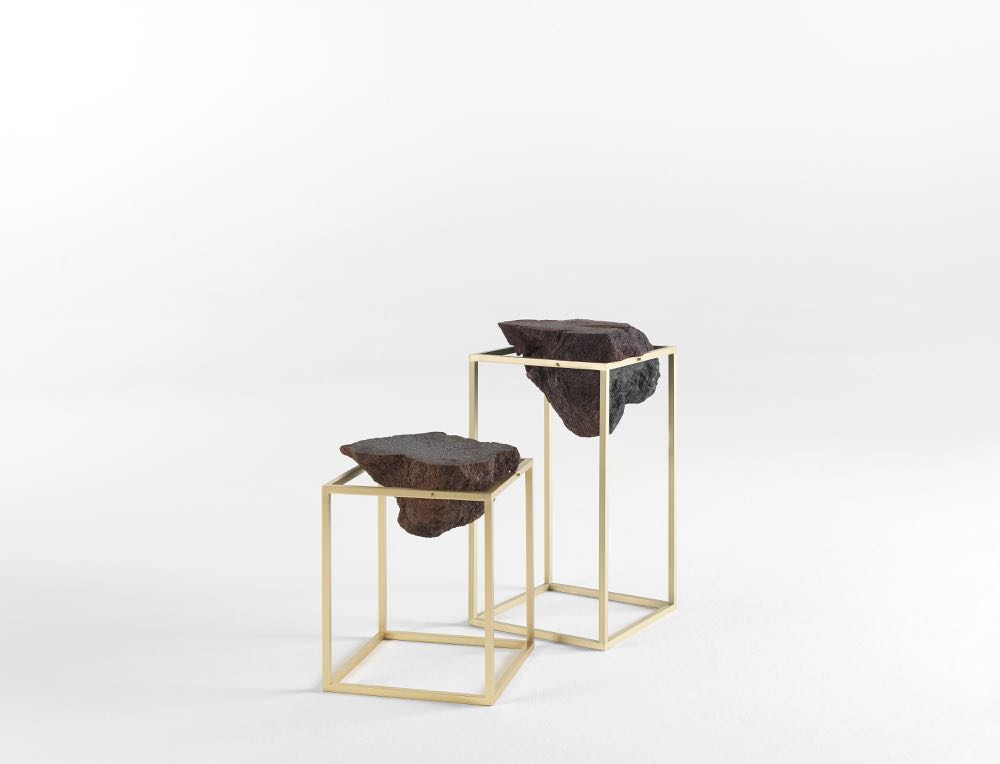 The 'Antivol' side table by CTRLZAK for JCP features lave stone blocks in an open brass frame.
