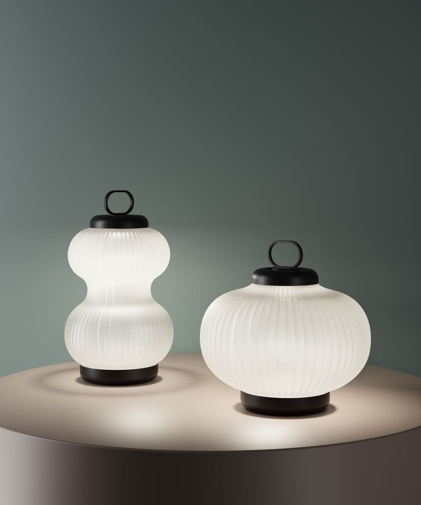 'Kanji' table lamps by Denis Guidone for Fontana Arte. Made from glass the lights are also available as pendants.