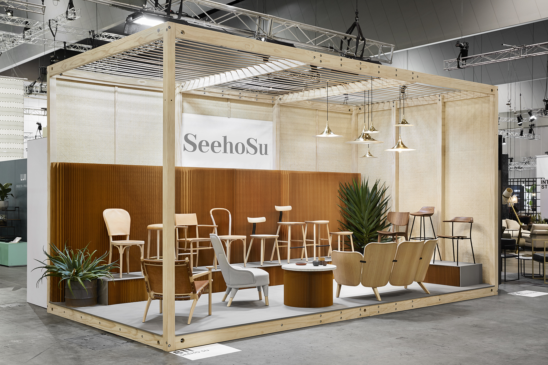 The SeehoSu stand featuring chairs from Maruni, Gemla, Gärsnäs plus Molo's 'Softwall' and a cluster of 'Semi' pendant lights from Gubi. Photograph by Tess Kelly.