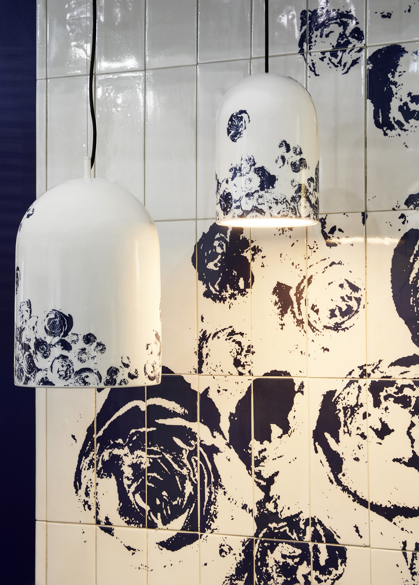 Abstracted natural prints in blue on white adorn both wall tiles and pendant lights by Porcelain Bear.Photograph by Haydn Cattach .