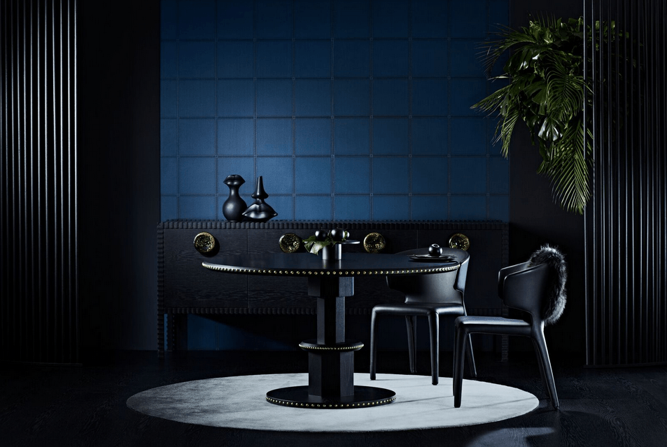 Zuster's new collection  Embellish  featuring a studded dining table and the 'Grand Buffet' with blown glass handles beyond.