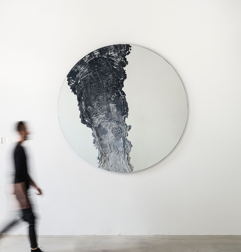 """The 'Drift' mirror by Fernando Mastrangelo was inspired by the volcanic eruptions of . The mirrors come in several variations in both inky blue / grey and sand coloured.         96              Normal   0           false   false   false     EN-US   X-NONE   X-NONE                                                                                                                                                                                                                                                                                                                                                                                                                                                                                                                                                                                                                                                                                                                                                                                                                                                                                 /* Style Definitions */ table.MsoNormalTable {mso-style-name:""""Table Normal""""; mso-tstyle-rowband-size:0; mso-tstyle-colband-size:0; mso-style-noshow:yes; mso-style-priority:99; mso-style-parent:""""""""; mso-padding-alt:0cm 5.4pt 0cm 5.4pt; mso-para-margin:0cm; mso-para-margin-bottom:.0001pt; mso-pagination:widow-orphan; font-size:12.0pt; font-family:Calibri; mso-ascii-font-family:Calibri; mso-ascii-theme-font:minor-latin; mso-hansi-font-family:Calibri; mso-hansi-theme-font:minor-latin;}     Photograph by Cary Whittier."""