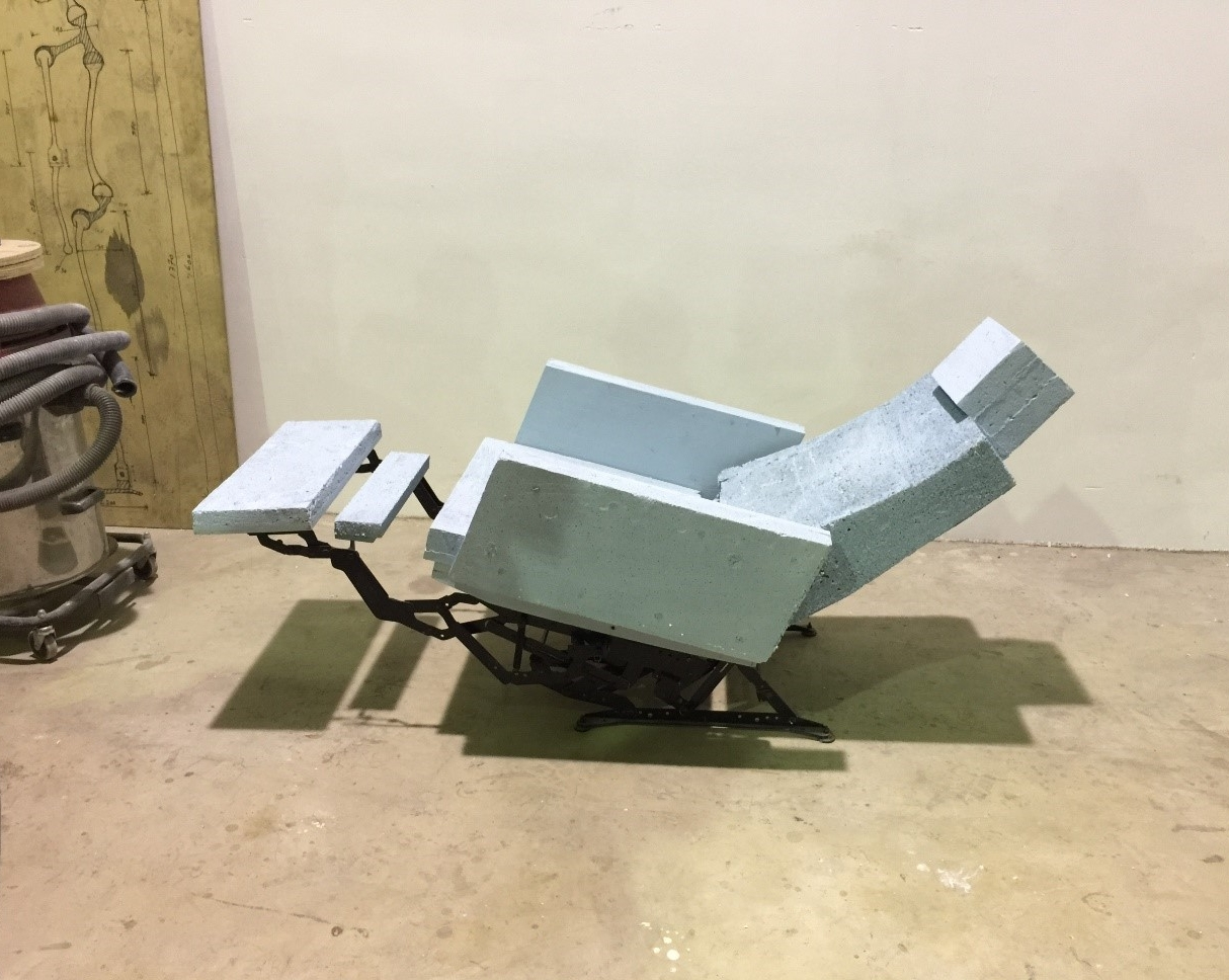 The 'Lazy Modernist' chair in its early form with roughly cut blocks of foam attached to the original metal structure.