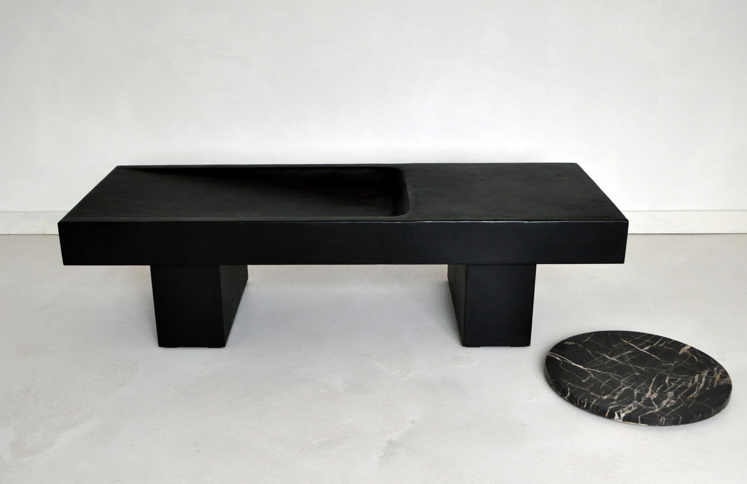Verheyden is represented in the UK by the Willer gallery in London's Kensington. Shown here is a leather clad table design and one of Verheyden's stone bowls.