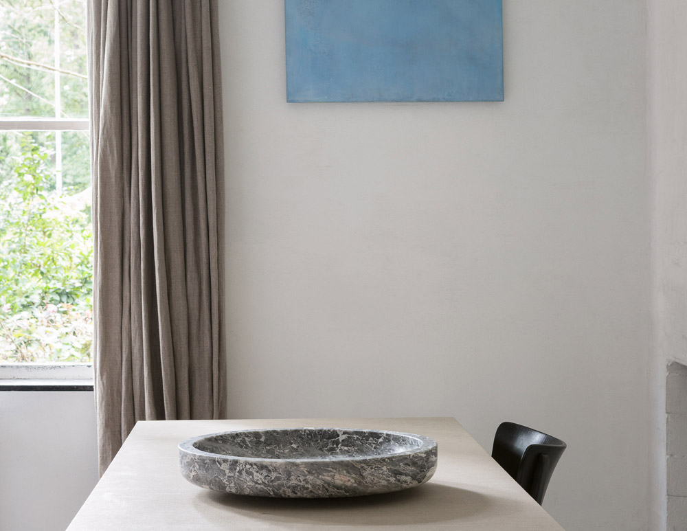 The refined simplicity of Verheyden's work is perfectly expressed in this photograph by Frederik-Vercruysse featuring one of the designers stone 'Komm' bowls.