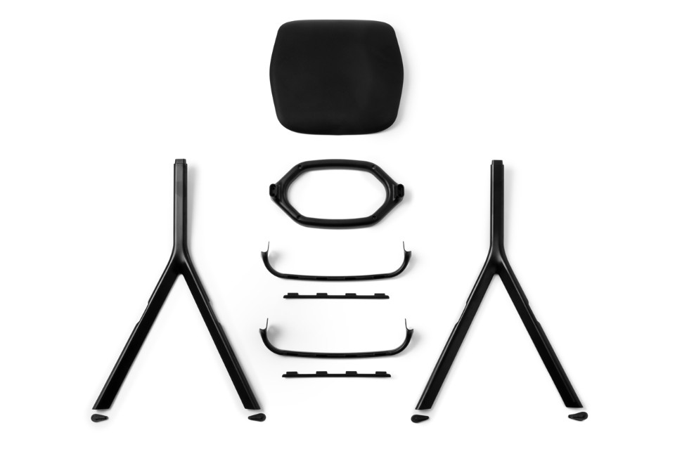 An exploded parts view of the 'AXYL' chair.