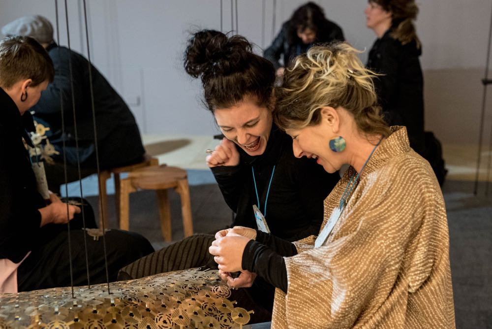 Claire Scorpo and Elliat Rich obviously having fun working on their Stitchfield installation.