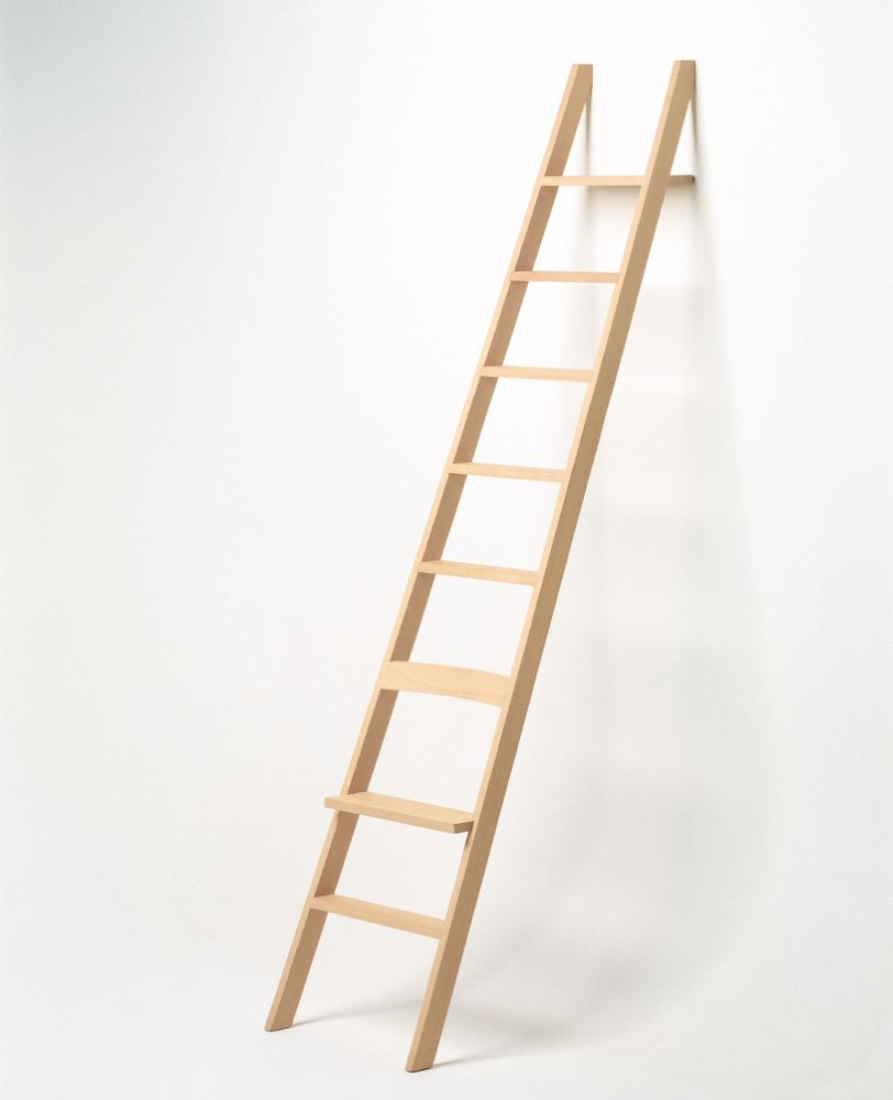 'The Ladder' is the perfect library ladder. The design encourages the owner to pick a book then sit down on the ladder and read. The design was released by Nils Holger Moormann in 1999. Photograph by Erik Brahl.