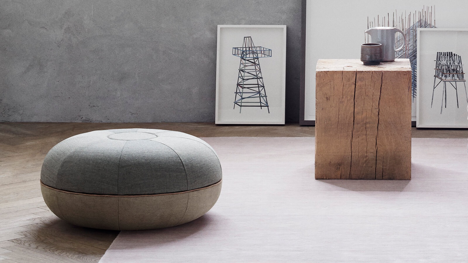 Manz's new 'Pouf' design for Fritz Hansen Objects. The design comes in indigo blue, pale pink and concrete with natural leather hide.(Poul Kjaerholm)