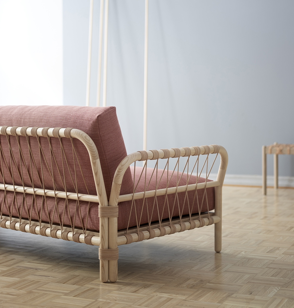 Alexander Lervik's extravaganza of materiality the 'Harper' sofa, combines woven leather cord and turned and bent ash wood.