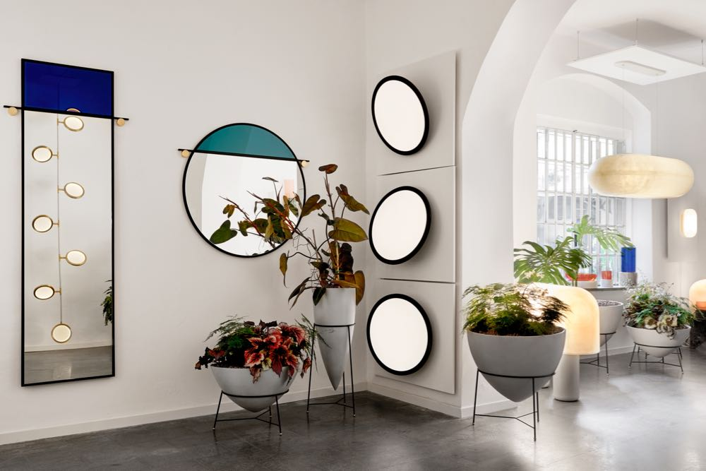 The  Matter Made  installation with their new Sergio Rodrigues designed cement planters, Faye Toogood 'Puffball' lights and 'Abal' mirrors from Studio Matter Made. Photo by Brooke Holm.