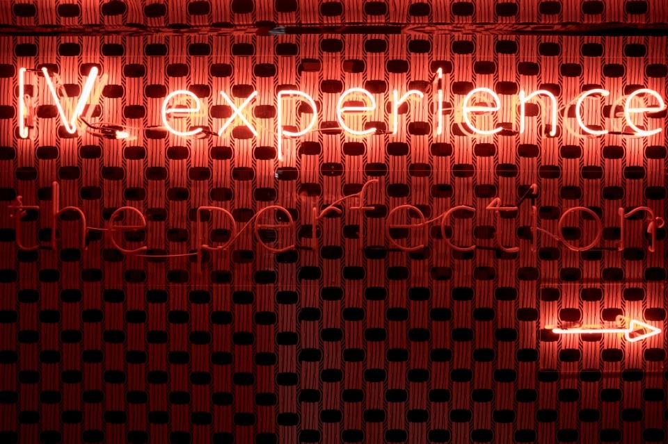 The entire installation was lit by neon signs and slogans such as 'Experience the Perfection'. Photo courtesy of Bulgari.
