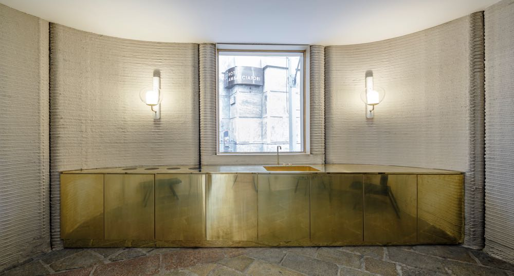 The curved walls were full of texture that offset the sleek brass interior joinery extremely well. The hope is that this sort of quick, accurate building will be used for low cost housing projects in the near future. Not sure the brass kitchen will be part of that plan! Photo by Luca Rotondo.