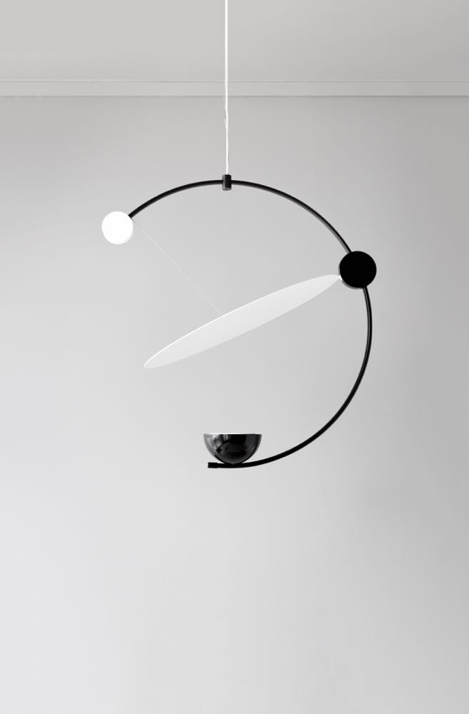 Cecilia Xinyu Zhang's 'Equant' light was on show at Salone Satellite. The diffuser disc can be moved to create different effects.
