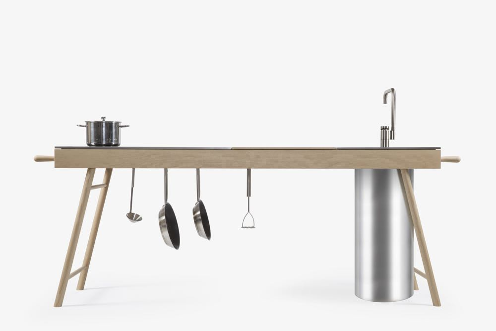Italian brand Stip  have created 'Critter Kitchen' - a solid timber table / bench with handles for tea towels at either end and rails from which to hang pots and pans. The Kitchen consists of an induction hob, preperation area, cutlery drawers, sink and tap.