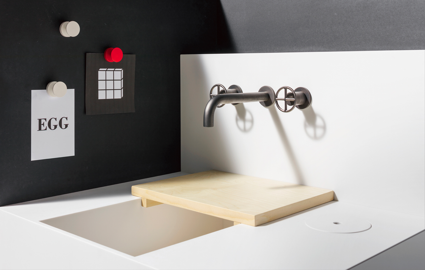 Elisa Ossino's  diminutive 'E0 01' kitchen for Japanese manufacturer  Sanwa . At only 1.2 square metres the kitchen should fit into even the smallest apartments. The kitchen features magnetic walls for notes & recipes, an integrated wooden cutting board, sink and dual induction hob. Photograph by Giuseppe De Francesco.