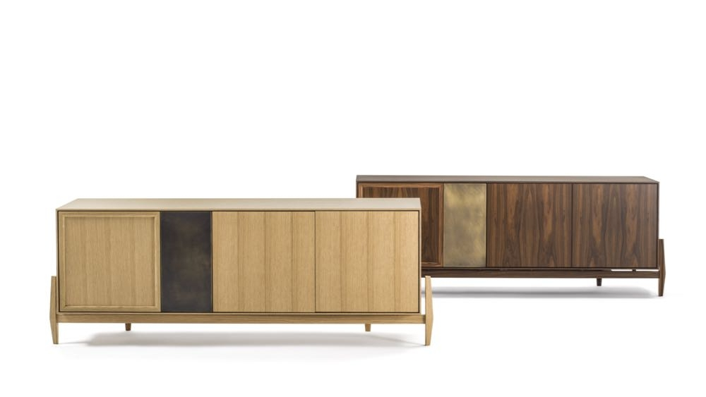 The 'Crab' sideboards by  Maurizio Di Lauro  for Durame incorporate a vertical panel of aged brass with oak or walnut doors and cabinet. The external legs are a very interesting feature of this design. The Crab collection also includes a tall wardrobe.
