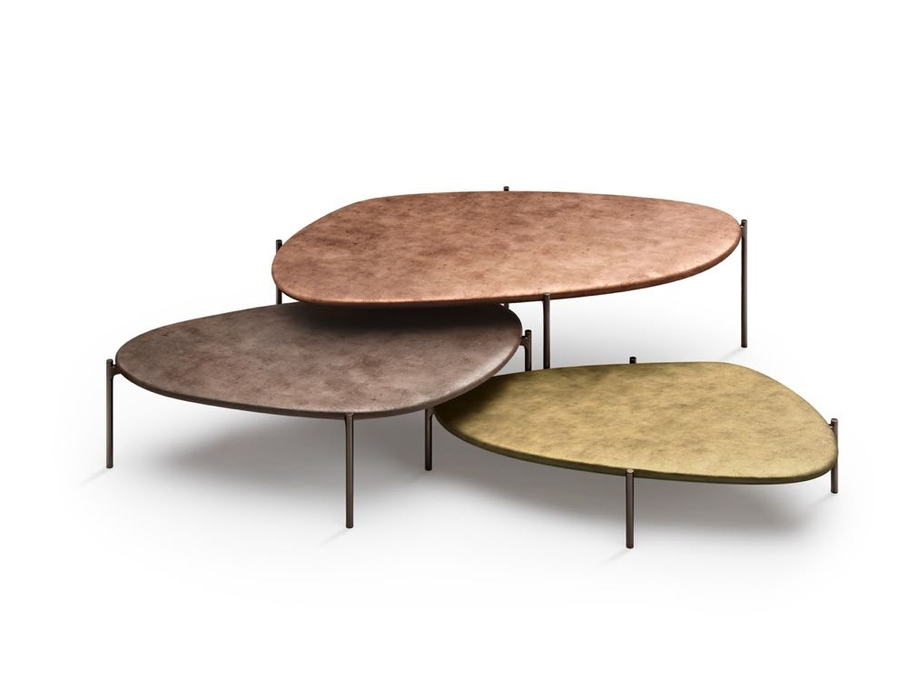 'Ishino' coffee tables by  Daï Sugasawa  for  Walter Knoll . These pebble-shaped low tables are cast metal with finishes ranging from aged bronze to copper and brass. Rather than a flat top like most tables, 'Ishino' seems to be under the effects of gravity becoming noticeably thicker underneath as if the metal has flowed there.