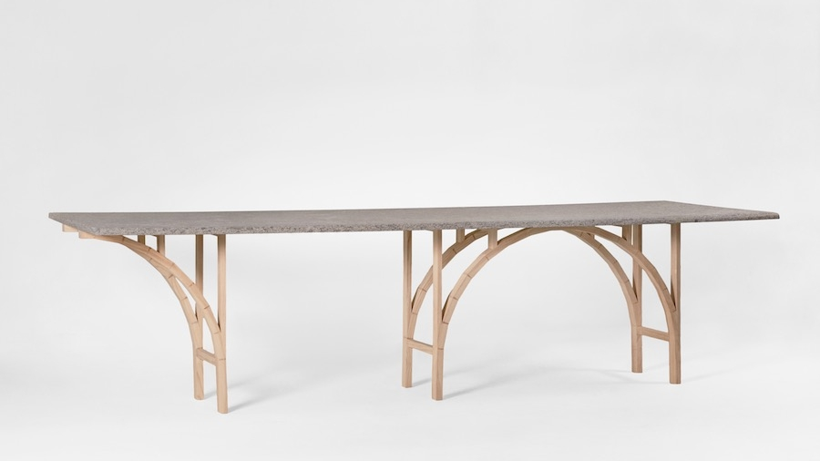 The 'ARCH' dining table by  Giacomo Moor  for limited edition gallery  Giustini / Stagetti . The stone top is supported by a series of timber 'bricks' in reference to the ancient process of making arches from small sections of masonry. Photo Giustini Stagetti.