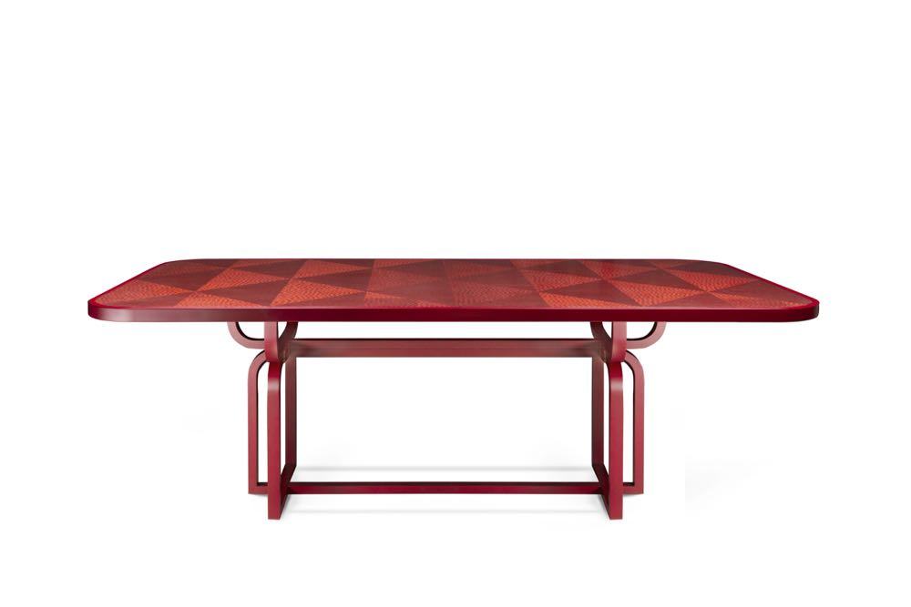Cristina Celestino 's 'Caryllon' marquetry dining table for Gebrüder Thonet Vienna (GTV). Very decorative but really quite amazing. Steam-bent  square section beech in red lacquer with triangular sections of veneer laid across the table's surface.
