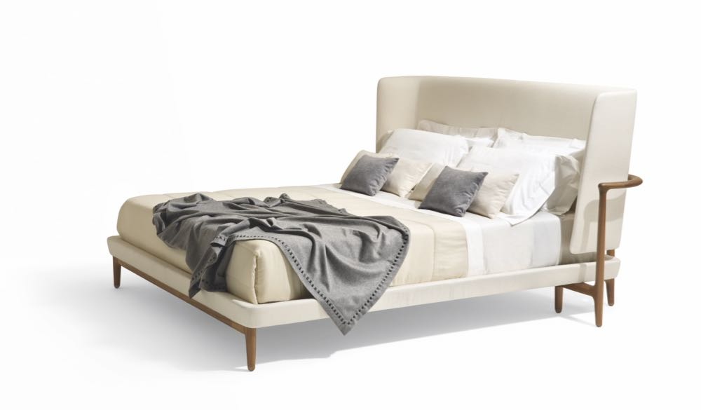 Like a lot of  Giorgetti  the 'Pegaso' bed by   Roberto Lazzeroni   is a little over the top but its hard not to be impressed by the sinuous, curved timber back of this particular bed. As a statement piece in a large room it would definitely be a bed fit for a king (or queen).