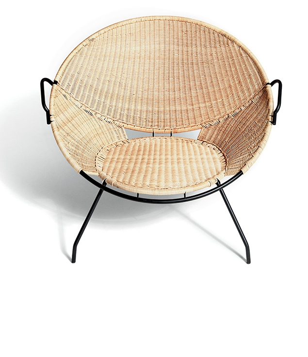 The T54 saucer-shaped lounge chair by Fratelli Monti from the historical archives of Bonacina   -   reissued by  De Padova . As the name suggests the rattan chair was designed in 1954.