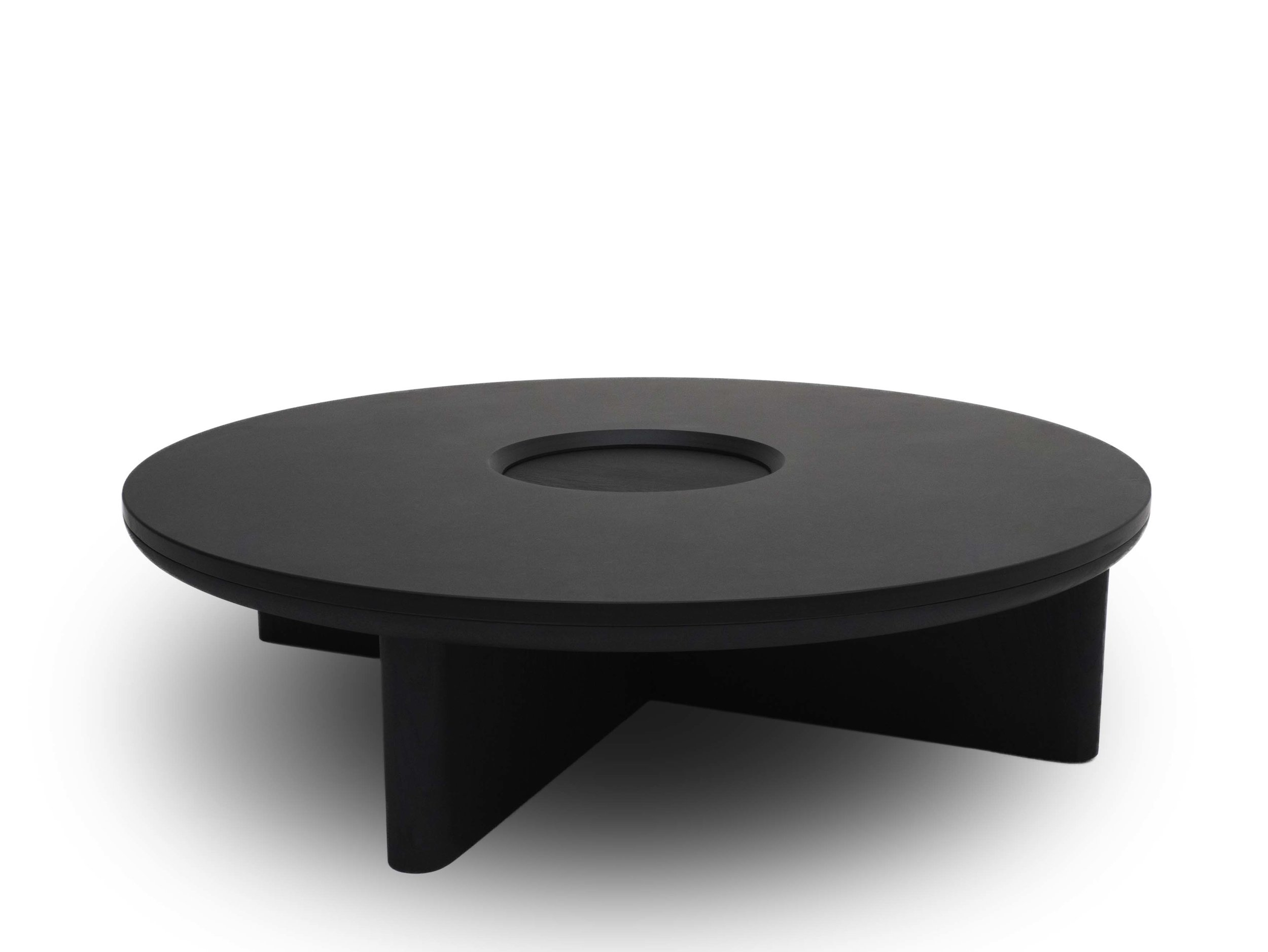 Brodie Neill's  coffee table for  Made in Ratio  features a massive slab of Cornish slate to great effect. Suitable supported by a solid oak cross base, the table is monolithic but extremely subtle to boot with its use of black on black.