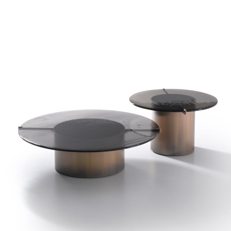 The 'Eight' coffee and side tables in slab glass with cylinders of aged metal from  Ivano Raedelli .