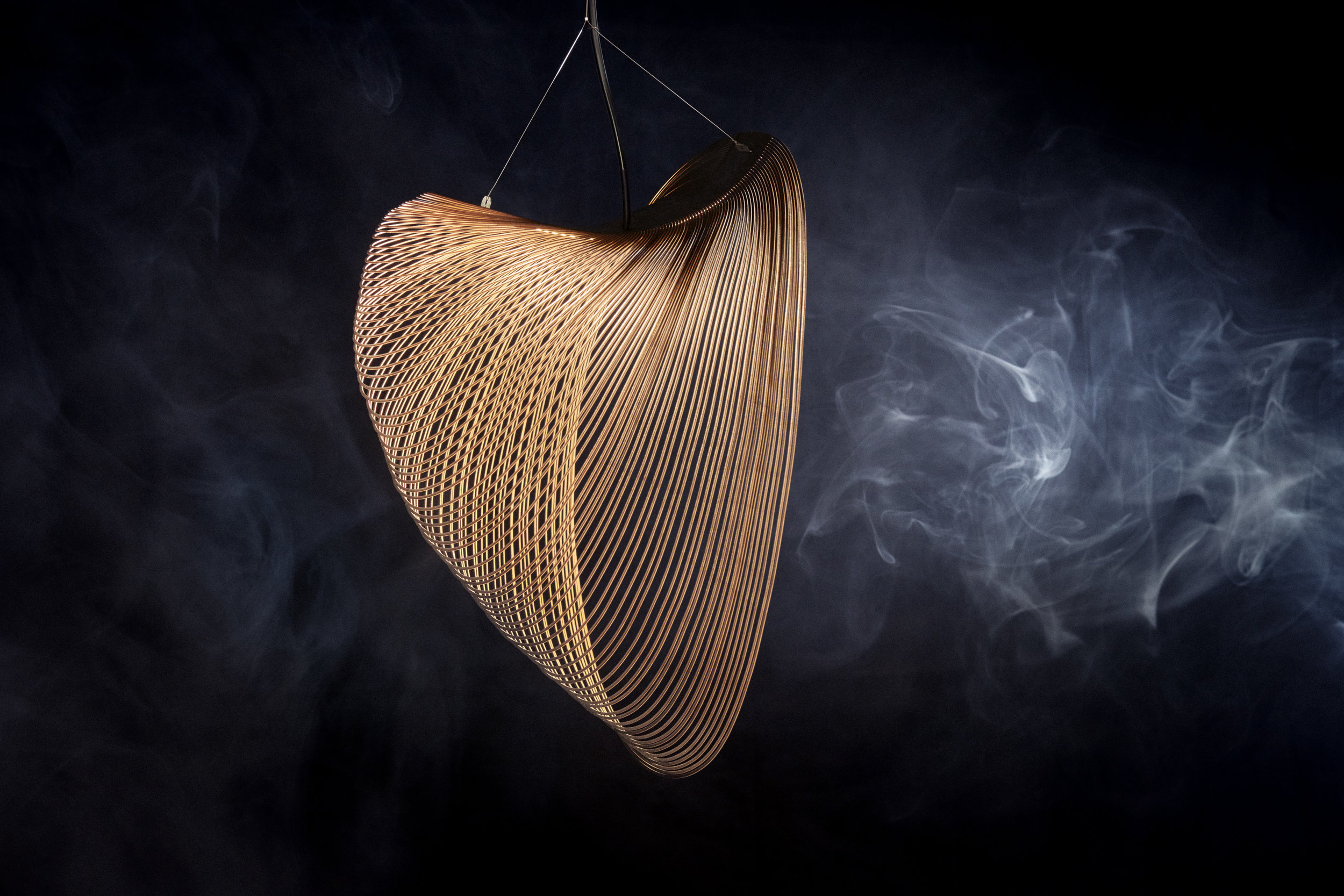 Zsuzsanna Horvath's 'Air' light in laser cut paper. Although impressive, the image doesn't relay  the delicacy and movement of the design which is quite incredible. Photo by Ville Vappula