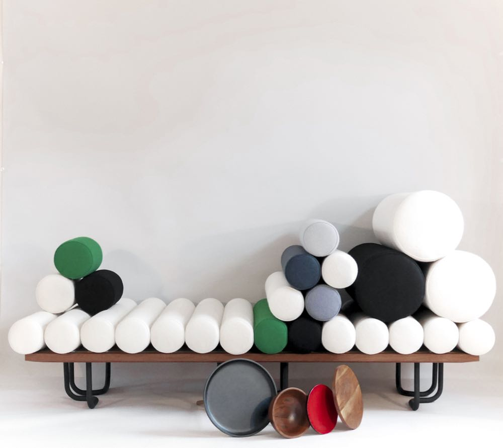 Felicia Arvid's sofa 'Addéra' shows the designers love of felted wool. The design is modular in the sense that the user can move side tables around and 'plug' them into the locations afforded by the sofa's tubular legs.