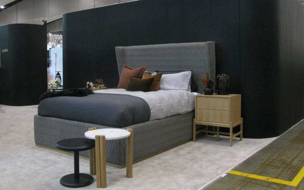 Zuster's new bed features a highly tactile finish in ribbon stitched suede.