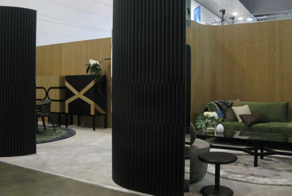 A view into the Zuster stand at DENFAIR 2018 showing the graphic strength of the brand's new 'Contour' cabinets.