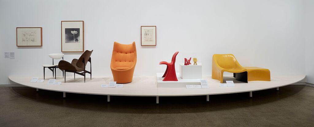 The Scape dining and lounge chair 1960 (left), Expo 67 Talking Chair from 1967 (in orange), The 73 chair (in red) with two maquettes from 1971 and the Poli chair and table also from 1971 (right).