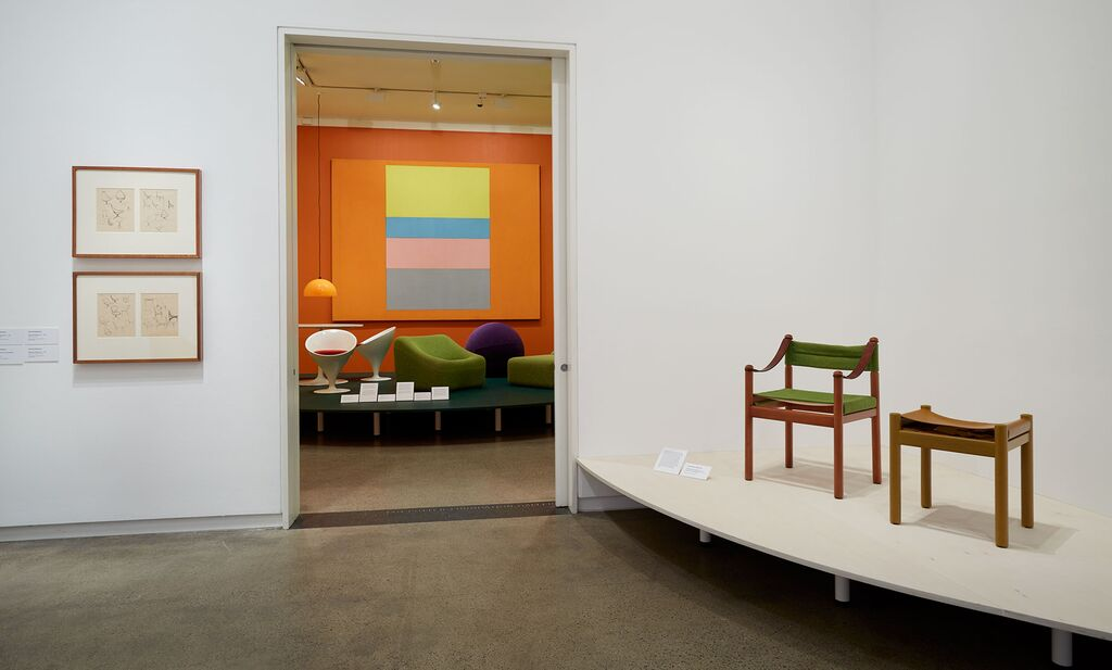 A Hob chair and stool from 1972 from the range of the same name that consisted of a table, chairs and stools manufactured by Moderntone. Stem chairs, Numero IV lounge chair and Obo seat in the room through the doorway.